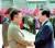 2000년 6월 13일 평양 순안공항에 도착한 김대중 전 대통령이 예상을 깨고 트랩까지 영접 나온 김정일 국방위원장의 두 손을 잡고 환하게 웃으며 인사말을 나누고 있다. 사진·중앙포토