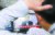 정부가 주택시장 안정 대책을 발표한 13일 오후 서울의 한 공인중개사 사무소에서 직원이 부동산 대책 발표 뉴스를 시청하고 있다. [뉴스1]