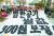 지난달 22일 서울 여의도 수출입은행 앞에서 열린 '전국농민대회'에 참가한 농민들이 '밥 한 공기 쌀값 300원 보장'을 촉구하고 있다. [뉴스1]