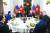 도널드 트럼프 미국 대통령과 김정은 북한 국무위원장이 27일 베트남 하노이 메트로폴 호텔에서 친교 만찬을 하고 있다. 왼쪽부터 이용호 외무상, 김영철 노동당 부위원장, 신혜영 통역관, 김 위원장, 트럼프 대통령, 이연향 통역관, 마이크 폼페이오 국무장관, 믹 멀베이니 백악관 비서실장 대행. [AFP=연합뉴스]
