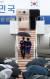 문재인 대통령이 오사카에서 열리는 G20 정상회의 참석차 27일 일본을 방문했다. 비가 내리는 가운데 간사이 국제공항에 도착한 문 대통령이 부인 김정숙 여사와 우산을 쓰고 전용기에서 내리고 있다. [청와대사진기자단]