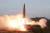 김정은 북한 국무위원장이 지난 25일 발사한 신형전술유도무기(단거리 탄도미사일). [연합뉴스]