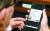 6일 오후 서울 여의도 국회에서 열린 법사위 조국 법무부 장관 후보자 인사청문회에서 박지원 의원이 휴대폰으로 전송된 조국 딸의 동양대학교 표창장을 보고 있다. [뉴시스]