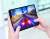 갤럭시 폴드를 펼친 화면에서 레이싱 게임 '아스팔트9'를 플레이하고 있다. [사진 삼성전자]