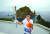 지난 26일 독도 경비대 헬기장에서 열린 제100회 전국체전 성화 채화 행사에서 허원석 독도 경비대장이 성화를 봉송하고 있다. [연합뉴스]