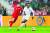 북한축구대표팀 공격수 한광성(왼쪽)은 손흥민처럼 등번호 7번을 달고 뛴다. [AP=연합뉴스]