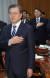 문재인 대통령이 지난달 8일 오후 청와대에서 열린 반부패정책협의회에서 국기에 대한 경례를 하고 있다.   문 대통령 뒤쪽은 윤석열 검찰총장. [연합뉴스]