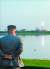 김정은 북한 국무위원장이 7월 25일 신형 단거리 탄도 미사일의 '위력시위사격'을 직접 조직, 지휘하며 발사장면을 지켜보고 있다. [조선중앙통신=연합뉴스]