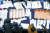 16일 자정 서울 종로구 종로개표소에서 개표사무원들이 비례대표 투표용지를 분류하고 있다. 길이가 48.1㎝에 달해 투표지 분류기를 사용하지 못하고 수작업으로 개표했다. [뉴시스]