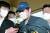 김봉현씨가 24일 오전 경찰 조사를 위해 경기도 수원시 경기남부지방경찰청 청사로 호송되고 있다. 연합뉴스
