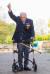 톰 무어 할아버지가 지난 16일(현지시간) 영국 북부 자신의 집 정원에서 25m 구간 100회 왕복을 마치고 손을 들어보이고 있다. [EPA=연합뉴스]