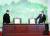 문재인 대통령(오른쪽)과 김정은 북한 국무위원장이 2018년 4월 27일 판문점 평화의 집에서 열린 남북정상회담에서 선언문에 서명하기 위해 자리에 앉고 있다. [사진공동취재단]
