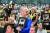 한국전쟁 참전용사 초청행사에 참석한 유족들. 가슴에 든 사진에는 참전용사의 모습이 담겨 있다. [사진 새에덴교회]