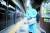 7일 오후 신종 코로나바이러스 감염증(코로나19) 확진자가 발생한 서울 지하철 2호선 시청역 승강장에서 관계자가 방역하고 있다. 연합뉴스