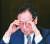 이우석 코오롱생명과학 대표가 지난해 7월 서울 중구 프레스 센터에서 열린 골관절염 유전자 치료제 '인보사케이주'(인보사)의 품목허가 취소 관련 기자회견에서 생각에 잠겨 있다. 이 대표는 현재 구속된 상태다. [연합뉴스]