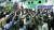 북한 노동당 기관지 노동신문이 지난 7일 1면에 게재한 김종태전기기관차 연합기업소 노동자들이 탈북자들을 규탄하는 모습. [노동신문=뉴스1]