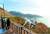국무총리실 산하 김해신공항 검증위원회가 타당성 검증 결과 발표를 하루 앞둔 16일 부산 강서구 가덕도동 대항항 전망대에서 관광객들이 가덕도 일대를 바라보고 있다. [연합뉴스]