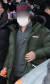 아동 성폭행 혐의로 징역 12년을 복역 후 출소한 조두순(68)이 12일 오전 경기도 안산준법지원센터에서 행정절차를 위해 이동하고 있다. 뉴스1
