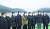 25일 부산에서 열린 '동남권 메가시티 구축 전략 보고'에 참석한 정부·여당 인사 및 관련 광역단체장들이 어업지도선 선상에서 가덕도신공항 예정지를 배경으로 기념사진을 찍고 있다. 왼쪽부터 변창흠 국토교통부 장관, 홍남기 경제부총리 겸 기획재정부 장관, 문성혁 해양수산부 장관, 김경수 경남지사, 김태년 민주당 원내대표, 전해철 행정안전부 장관, 이광재 민주당 의원, 이낙연 민주당 대표, 송철호 울산시장. 청와대사진기자단