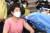 26일 오전 서울 노원구 보건소에서 1호 접종자인 이경순(61) 요양보호사(상계요양원)가 아스트라제네카(AZ) 백신 접종을 받고 있다. 사진 노원구청