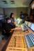 20일 서울 예술의전당 콘서트홀의 음향실에서 오케스트라 총보를 보며 중계 화면을 제작하는 스코어리더 권수정(일어선 이)씨. [사진 예술의전당]