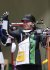24일 아사카 사격장에서 열린 도쿄올림픽 10m 여자 공기소총 결선에서 대한민국 권은지가 자신의 이름이 불리자 손을 들고 인사하고 있다. [연합뉴스]