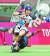 장정민이 7인제 럭비 일본과 최하위 결정전에서 수비수를 제치고 공격하고 있다. [연합뉴스]