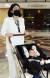 용혜인 기본소득당 의원이 지난달 5일 출산 후 서울 영등포구 국회에 출근해 본회의장을 지나고 있다. 임현동 기자