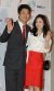김태욱과 채시라가 정준호·이하정씨 결혼식이 열린 2011년 3월 25일 서울 쉐라톤 워커힐 호텔에 하객으로 참석해 결혼을 축하하는 밝은 포즈를 취하고 있다. 중앙포토
