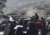 탈레반 무장대원들이 기관총이 설치된 차를 타고 시위대로 돌진하고 있다. [사진 더선]