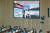 지난 8일 곽상도 국민의힘 의원이 예결위회의에서 이스타항공 의혹을 질타하며 띄운 동영상을 의원들이 주시하고 있다. [연합뉴스]