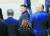 북한 김정은 국무위원장이 2019년 6월 30일 판문점에서 문재인 대통령과 도널드 트럼프 당시 미국 대통령의 배웅을 받으며 군사분계선을 넘어 북측으로 돌아가다 뒤돌아보고 있다. 연합뉴스
