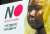 26일 서울 주한 일본대사관 앞 소녀상 뒤로 일본 제품 불매 포스터가 보이고 있다. [연합뉴스]