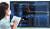 14일 오후 서울 종로구 연합인포맥스 모니터에 카카오게임즈 주가 그래프가 표시되고 있다. [연합뉴스]