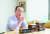 김인규 한국장애인재활협회장이 취재수첩 30권에 적어 놓은 3김 관련 기록에 대해 설명하고 있다.